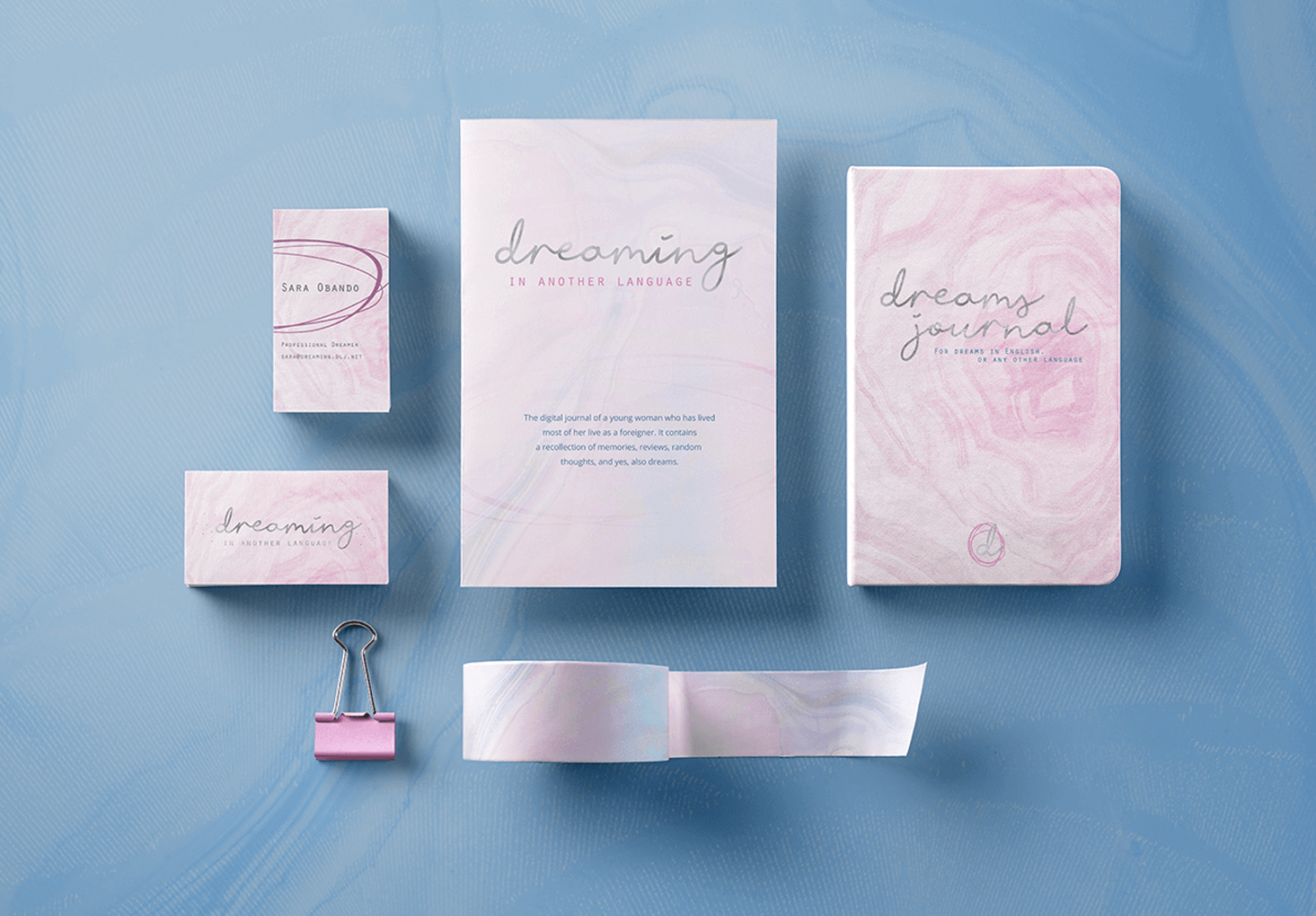 Flat lay photo showcasing branded stationery items for Dreaming in Another Language