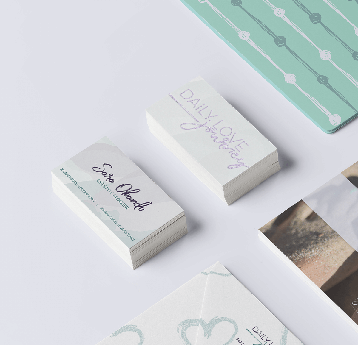 Stationery closeup of the business cards for Daily Love Journey