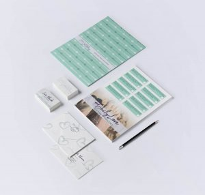Flat lay photo showcasing branded stationery items for Daily Love Journey