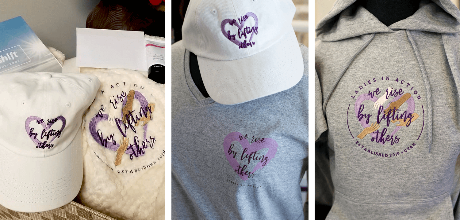 Ladies in Action logo and brand elements featured on branded merchandise: embroidered on a baseball cap and a blanket, printed on a shirt, and embroidered on a hoodie.