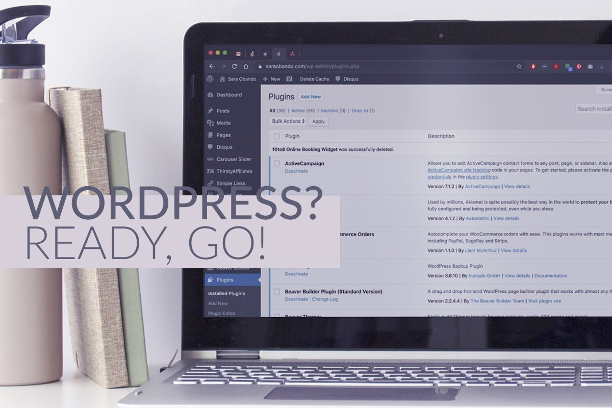 Cover for WordPress? Ready, Go! Showing a laptop on a desk that has a WordPress admin area on the browser.