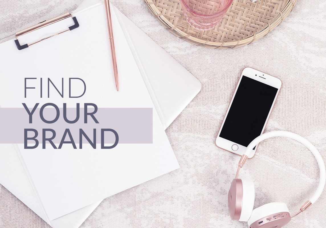 Find Your Brand Course Cover - A note pad, a pen, a cellphone, and a headset thrown on the bed.